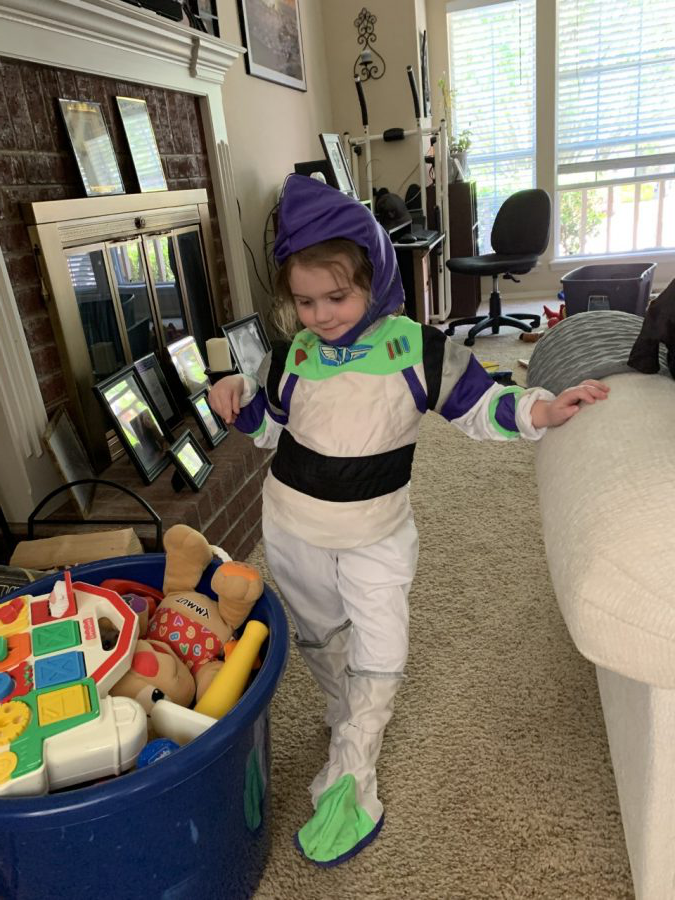 Langley Sixkiller, Niece of Senior Camden Barker, Striking a Pose in Her Buzz Lightyear Costume